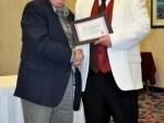 Bill Shalaby receiving an award
